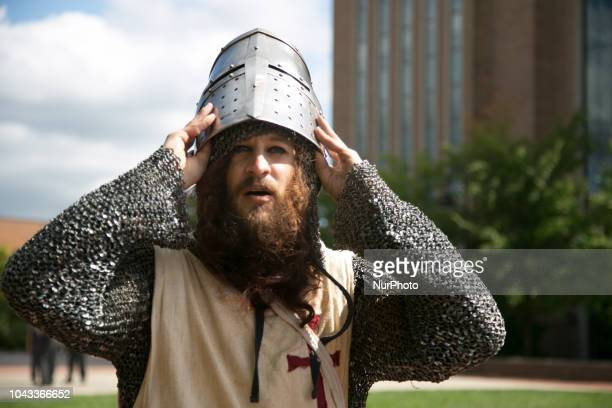 A man dressed as a Crusades knight takes off his helmet during an open carry rally at Kent State University in Kent Ohio on September 29 2018