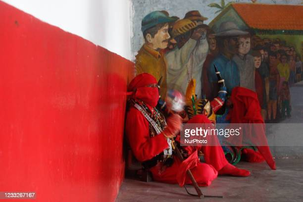 Man dressed as a dancing devil plays a maraca during the celebration of Corpus Christi amidst the Coronavirus pandemic in San Francisco de Yare,...