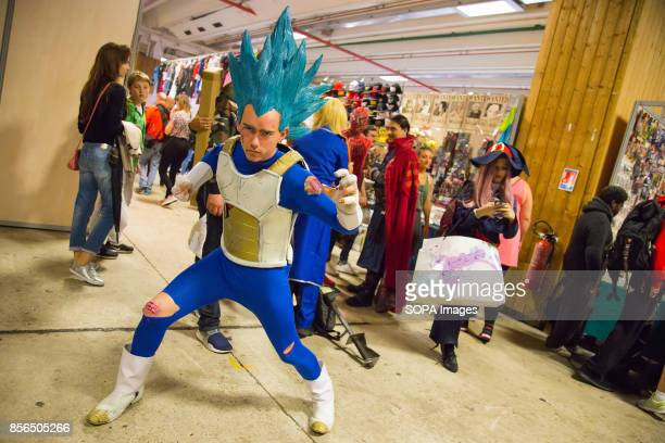 A man dressed as a dragon ball manga character is pictured during the 24th edition of the Paris Manga SciFi Show mostly devoted to Japanese...