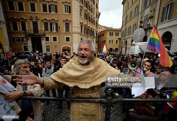 A man dressed as a friar demonstrate against samesex civil unions outside the Italian Parliament in Rome on May 11 2016 Italy's parliament gave a...