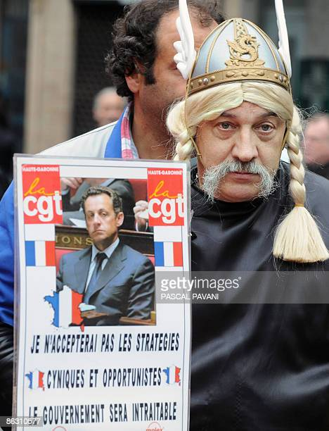 A man dressed as a Gallic holds a placard with a picture of French president Nicolas Sarkozy reading 'I will not accept the cynical and opportunistic...