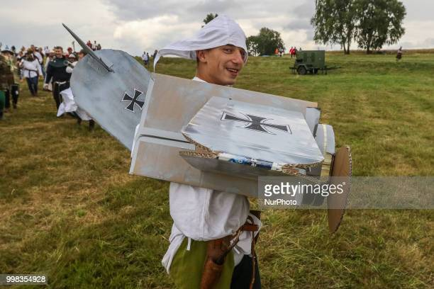 Man dressed as a German WWII airplane is seen in Grunwald Poland on 13 July 2018 Battle of Grunwald reenactment participants take part in the last...