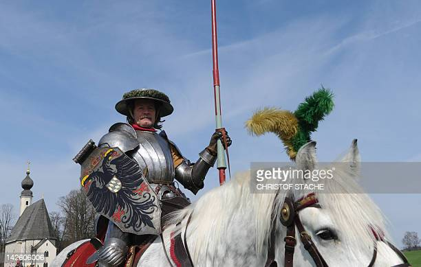 A man dressed as a knight on a festively decorated horse takes part in the traditional St Georgi Ride on April 9 2019 in Traunstein southern Germany...