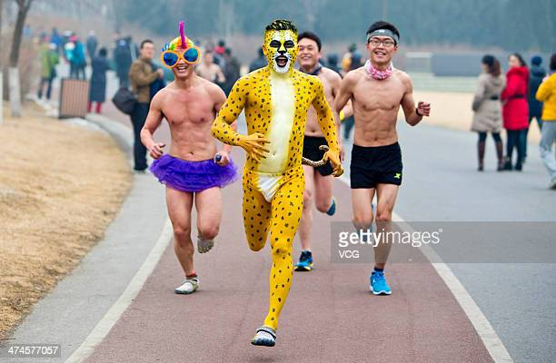 Man dressed as a leopard takes part in the annual 3.5 km undie run at Olympic Forst Park on February 23 in Beijing, China. More than 200 people who...