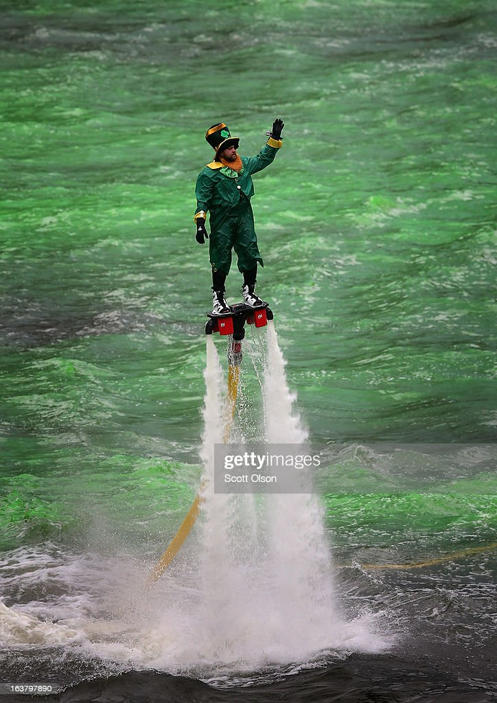 A man dressed as a leprechaun entertains the crowd on a water propelled Flyboard while workers dye the Chicago River green to kick off the city's St. Patrick's day celebration on March 16, 2013 in Chicago, Illinois. The dying of the river has been a tradition in the city for 43 years.