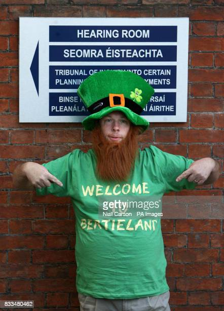A man dressed as a leprechaun on his way into the Mahon Tribunal to hear Taoiseach Bertie Ahern facing questions about his 1990s financial affairs an...