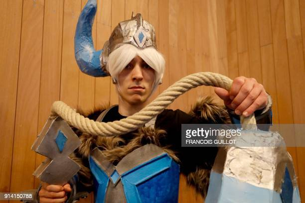 A man dressed as a manga character poses at the 25th edition of the Paris Manga and Scifi show on February 4 2018 in Paris / AFP PHOTO / FRANCOIS...