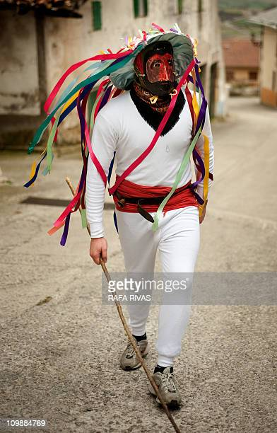 A man dressed as a momotxorro mythological character looks for people to chase on March 8 2011 during the ancient carnival of Unanu in the north of...