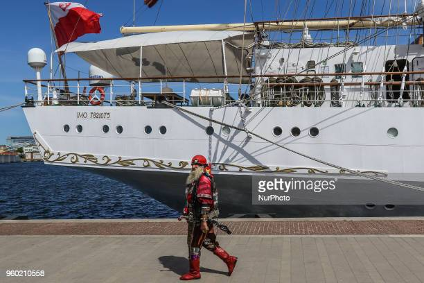 Man dressed as a pirate walking along the STS Dar Mlodziezy sail training ship is seen in Gdynia Poland on 19 May 2018 Dar Mlodziezy first...