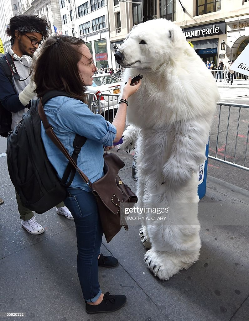 A man dressed as a Polar Bear is interviewed as protestors take part in the 'Flood Wall Street' demonstrations on September 22, 2014, preceding the United Nations's 'Climate Summit 2014: Catalyzing Action' in New York. AFP PHOTO/Timothy A. Clary