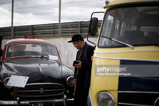A man dressed as a priest looks at a Taxi Renault Fregate form the 50s at the Jarama Circuit on June 9 2013 in Madrid Spain The Jarama Vintage...