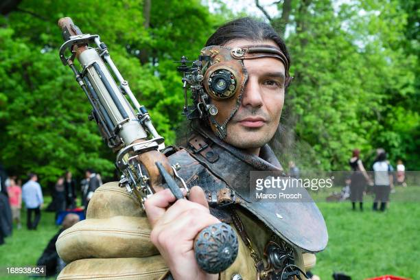 A man dressed as a steampunk attends the traditional park picnic on the first day of the annual WaveGotik Treffen or Wave and Goth Festival on May 17...