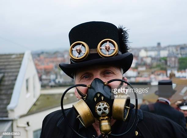 A man dressed as a steampunk climbs the steps to the abbey during the Goth weekend on April 26 2014 in Whitby England The Whitby Goth weekend began...