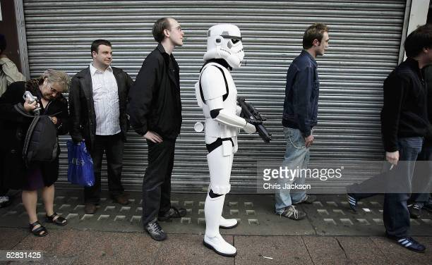 A man dressed as a Storm trooper queues to get in to the first ever screening of the entire sixfilm Star Wars saga in Leicester Square on May 16 2005...