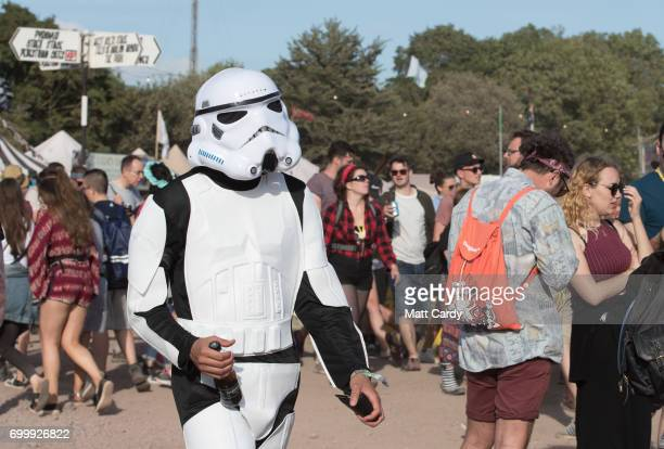 A man dressed as a Storm Trooper walks around the Glastonbury Festival site at Worthy Farm in Pilton on June 22 2017 near Glastonbury England The...