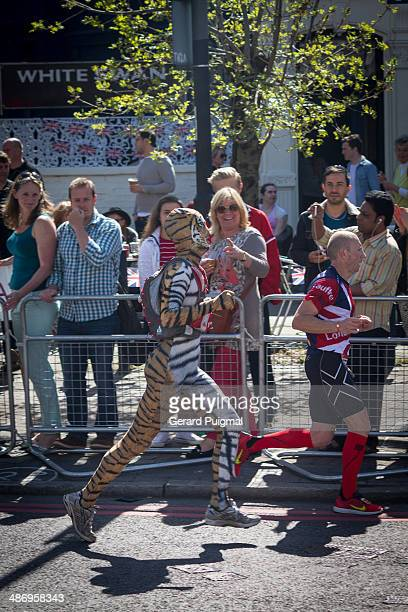 Man dressed as a tiger is running in the London Marathon 2014