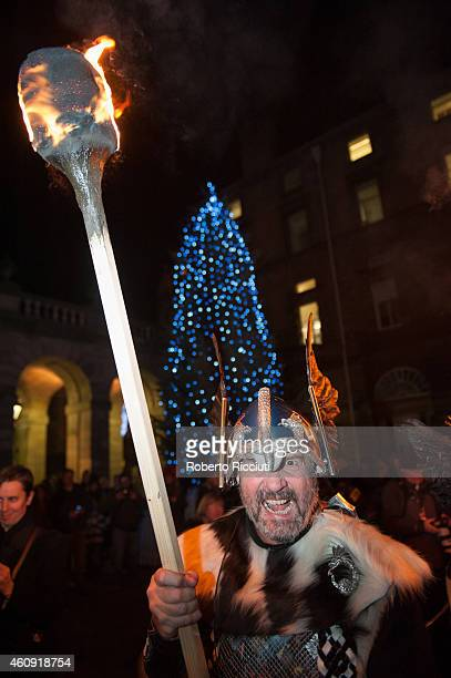 A man dressed as a Viking takes part in the torchlight procession as it makes its way through Edinburgh for the start of the Hogmanay celebrations on...