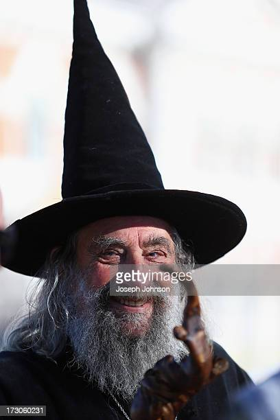A man dressed as a wizard looks on as the Christchurch Public were invited to look at the art new seating planters and performance space after...