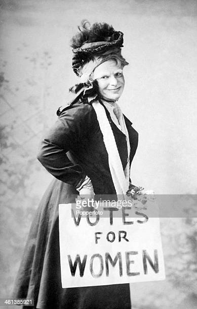 A man dressed as a woman and purportiing to be a suffragette supporting 'Votes for Women' circa 1920