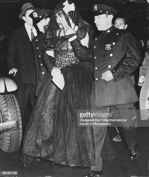 A man dressed as a woman is arrested by uniformed police officers New York ca 1939 The cops the old meanies broke up their dance Photo by...