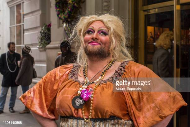 a man dressed as a woman smiling in the street during the mardi gras celebration at new orleans carnival, louisiana, usa. - mardi gras fun in new orleans stock photos and pictures