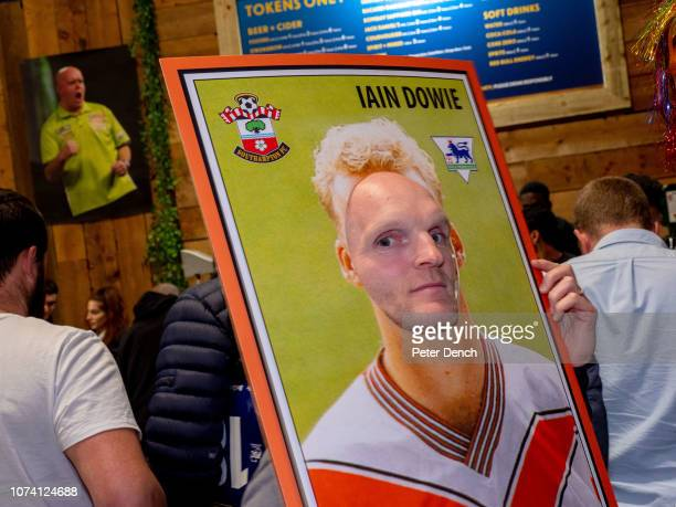 A man dressed as an Iain Dowie football sticker at the Darts Fan Village in Alexandra Palace on December 16 2018 in London England