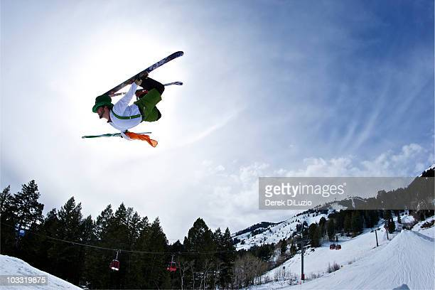 A man dressed as an Irish leprechaun jumps on his skis in Wyoming.