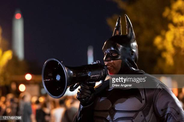A man dressed as Batman joins the protest near Lafayette Park and the White House on June 3 2020 in Washington DC Protests in cities throughout the...