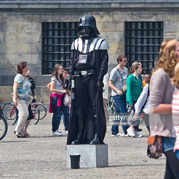 Man dressed as Darth Vader in De Dam square in the center of Amsterdam