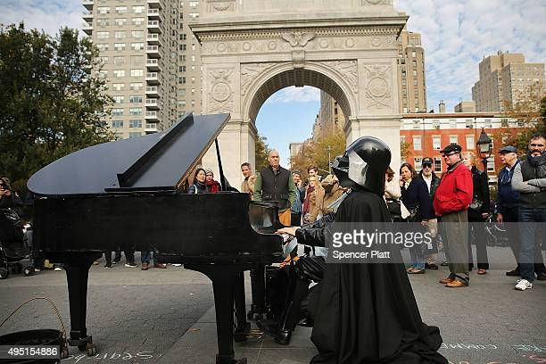 A man dressed as Darth Vader plays the piano during Halloween festivities in Halloween Washington Square Park on October 31 2015 in New York City...