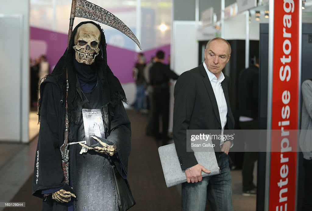 A man dressed as Death and advertising a trade fair exhibitor roams the exhibition halls at the 2013 CeBIT technology trade fair on March 5, 2013 in Hanover, Germany. CeBIT will be open March 5-9.