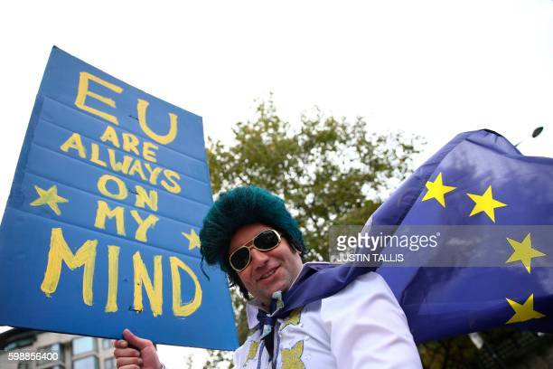 A man dressed as Elvis Presley stands with a proEurope placard as people gathered for a March for Europe protest to against the Brexit vote in London...