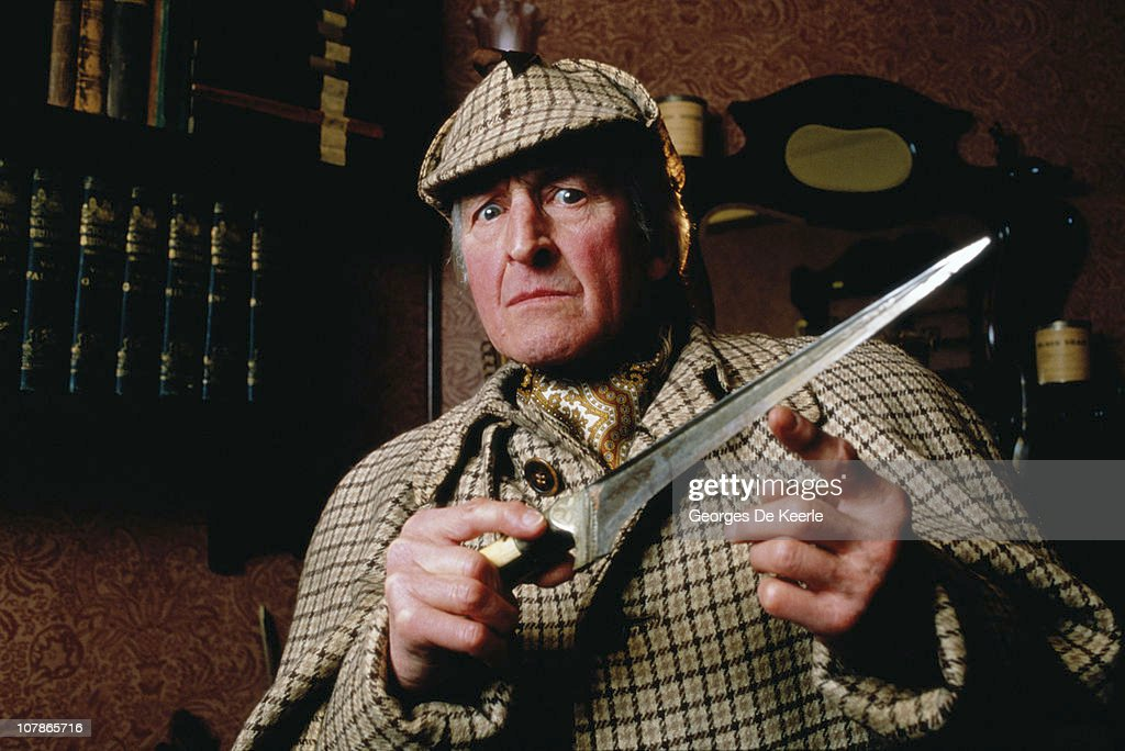 A man dressed as fictional detective Sherlock Holmes, and wielding a large knife, 8th December 1986.