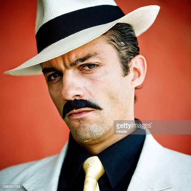 Man Dressed as Gangster in Suit
