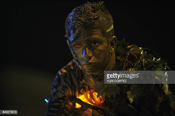 A man dressed as half machine and half tree performs in a float during the Light Festival Parade in San Jose on December 13 2008 as part of the...