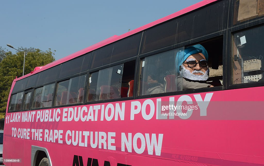 A man dressed as Indian Prime Minister Manmohan Singh sits on the 'Pink Bus' which launched the Campaign for Education as the solution to cure India's rape epidemic at Munirka Bus stand in New Delhi on January 24, 2013. After one month of lurid reporting on a horrifying gang-rape and murder of a student in a bus by five men in New Delhi, women in the Indian capital say they are not safe in Delhi.