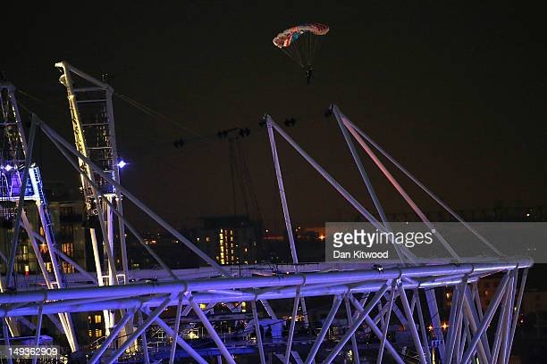 Man dressed as James Bond parachutes into the Olympic stadium during the opening ceremony of the 2012 London Olympic Games on July 27, 2012 in...