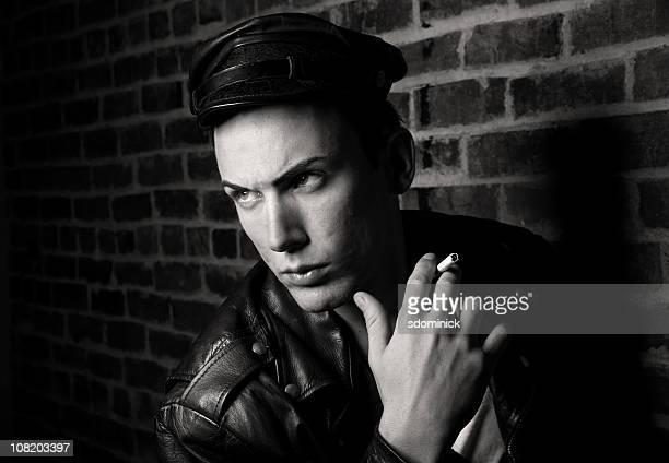 man dressed as james dean character - biker jacket stock photos and pictures
