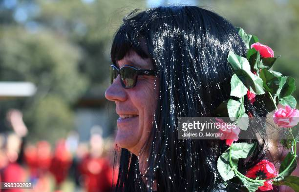 Man dressed as Kate Bush in a park with hundreds of others on July 14, 2018 in Sydney, Australia. The Most Wuthering Heights Day is when people all...