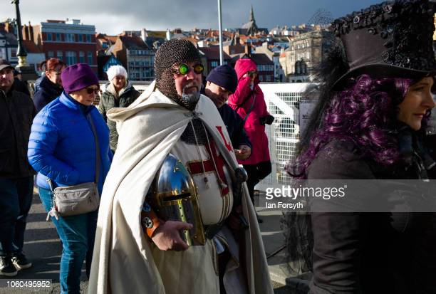 A man dressed as King Arthur cross the swing bridge during Whitby Goth Weekend on October 28 2018 in Whitby England Whitby Goth weekend began in 1994...