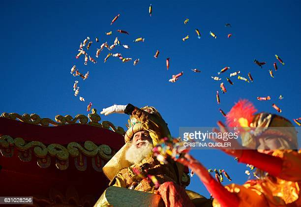 A man dressed as King Caspar one of the three wise men or the Three Kings throws candies during the Three Wise Men Parade in Sevilla on January 5...