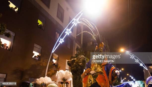 A man dressed as King Caspar one the three wise men or Kings rides a camel during the Three Wise Men Parade in Tenerife on the Spanish Canary island...