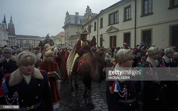 A man dressed as king gaspar rides a camel during a traditional Three Wise Men march from Prague Hradcany Castle to Bethlehem's menger on January 5...
