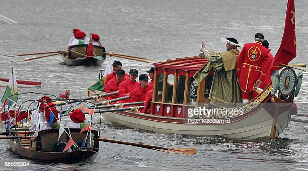 A man dressed as King Henry VIII is rowed along the River Thames in the Royal Shallop Jubilant near Teddington Lock on June 20 2009 in London A...