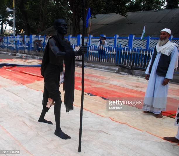 A man dressed as Mahatma Gandhi during the protest against Bharatiya Janata Party on the occasion of 25th anniversary of the demolition of Babri...