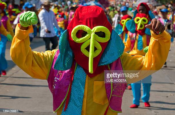 A man dressed as 'Marimonda' typical character of the carnival of Barranquilla performs during the third day of parade in Barranquilla Colombia on...