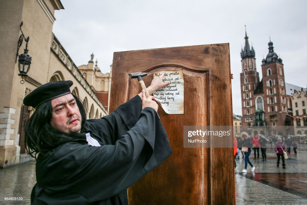 A man dressed as Martin Luther nails a copy of \u0027 95 Theses \u0027 to the  sc 1 st  Getty Images & 500th anniversary of the Protestant Reformation in Poland Photos and ...