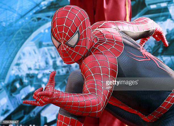 A man dressed as Marvel comics hero Spiderman poses for the press at the Hollywood theme park Universal Studios Japan which has an attraction titled...
