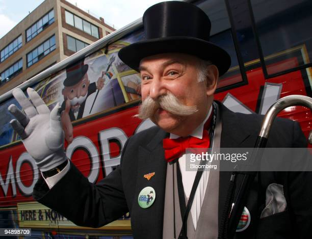 A man dressed as Mr Monopoly from Hasbro Inc's popular Monopoly board game poses outside the Hasbro New York Toy Fair 2008 in New York US on Friday...