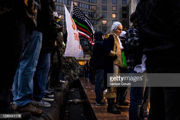 Man dressed as President George Washington stands with supporters of President Donald Trump for a rally at Freedom Plaza on January 5, 2021 in...